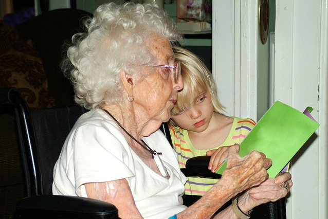 reading-with-grandmother-in-wheelchair-1432646-638x425